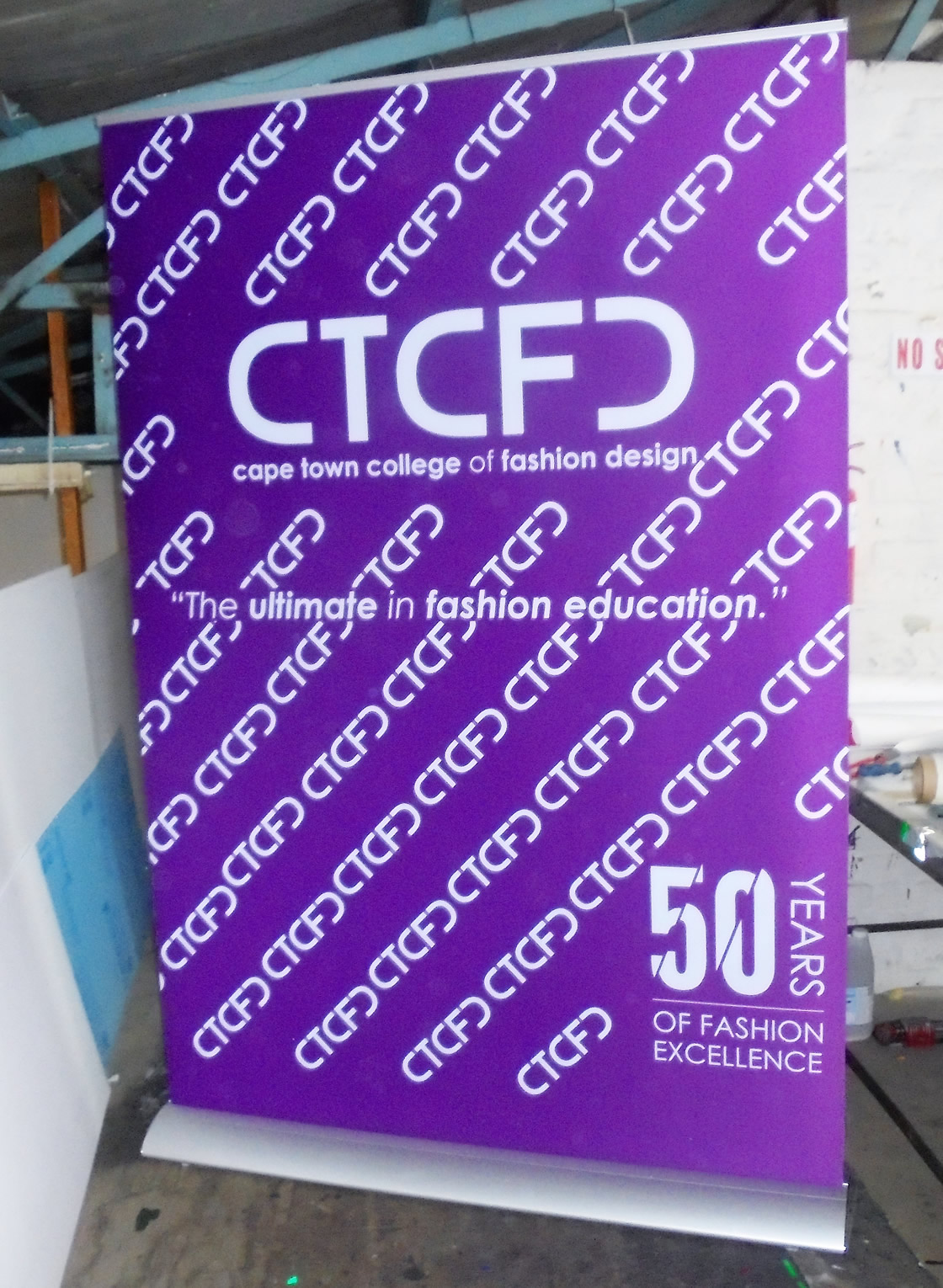 This is an example of a banner being used to advertise the Cape Town College of Fashion Design, by Vye Graphics.
