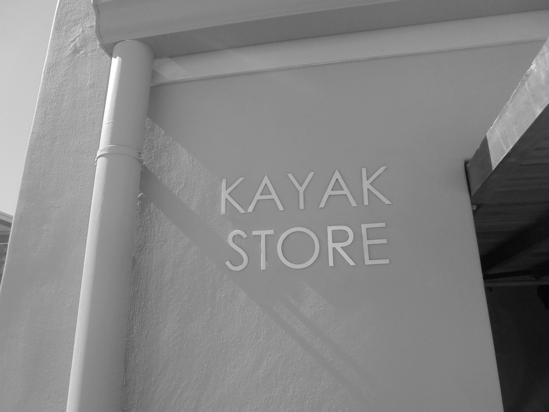Example of a sign that was created for Kayak Store by graphics design company Vye Graphics.