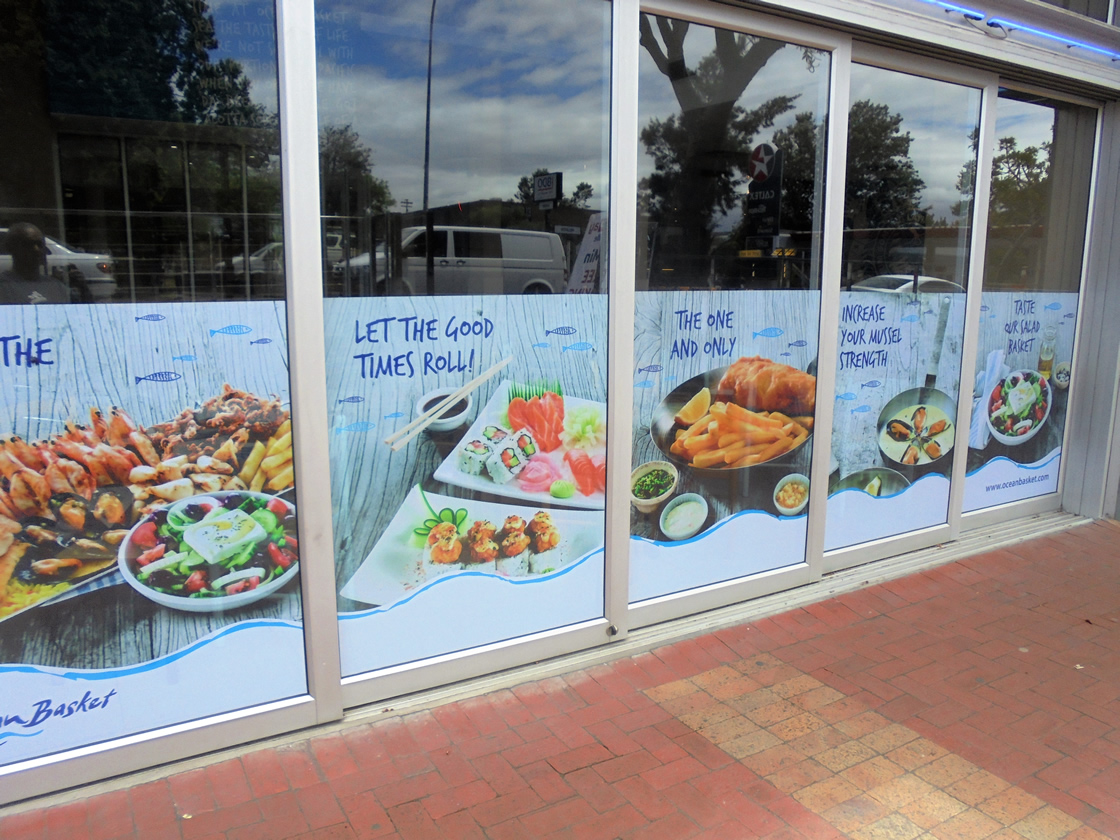 This is a cutout sign, made by Vye Graphics, for the restaurant Ocean Basket.