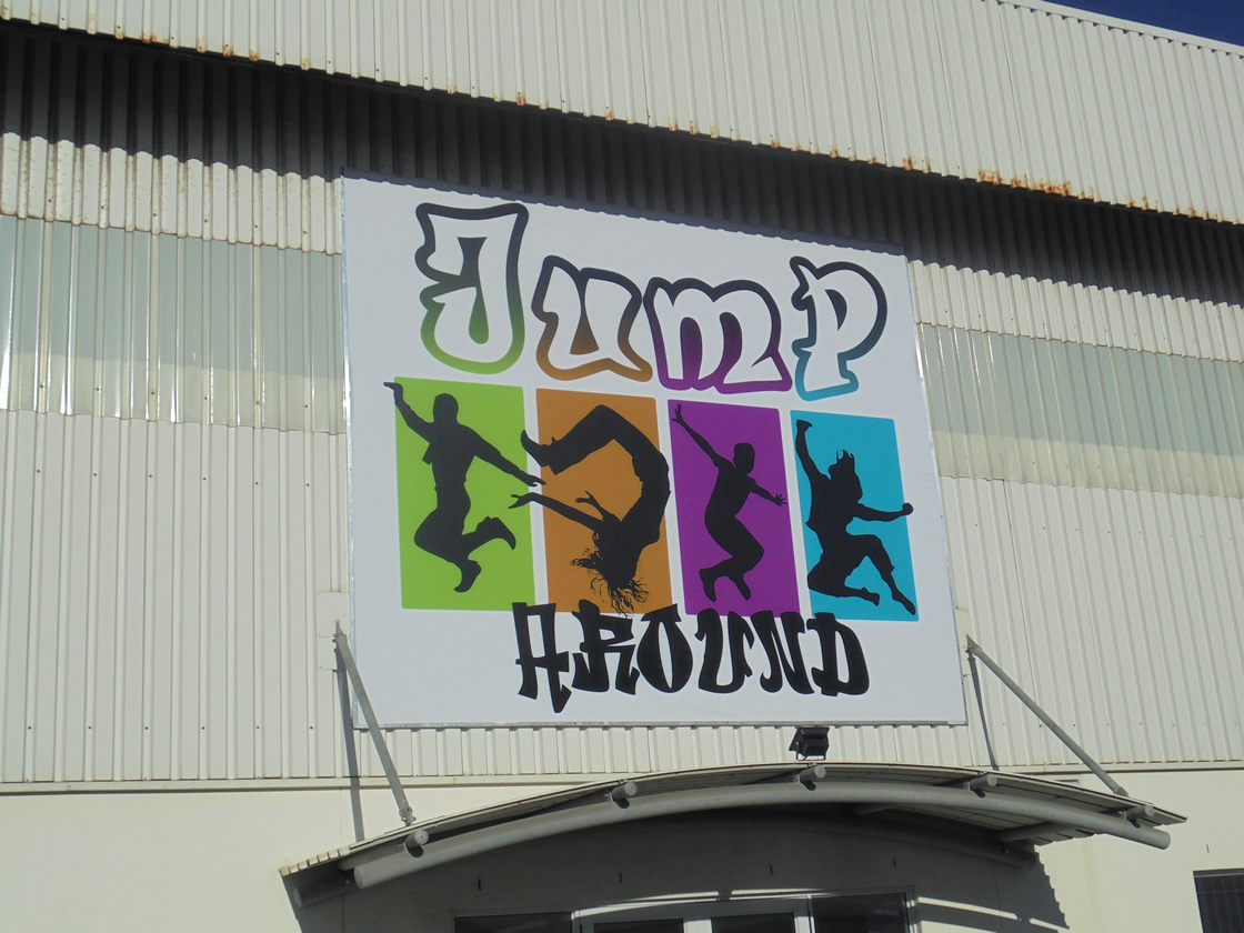 This is an example of a flex face sign placed on a corrugated wall, for the company Jump Around, by the design company Vye Graphics.