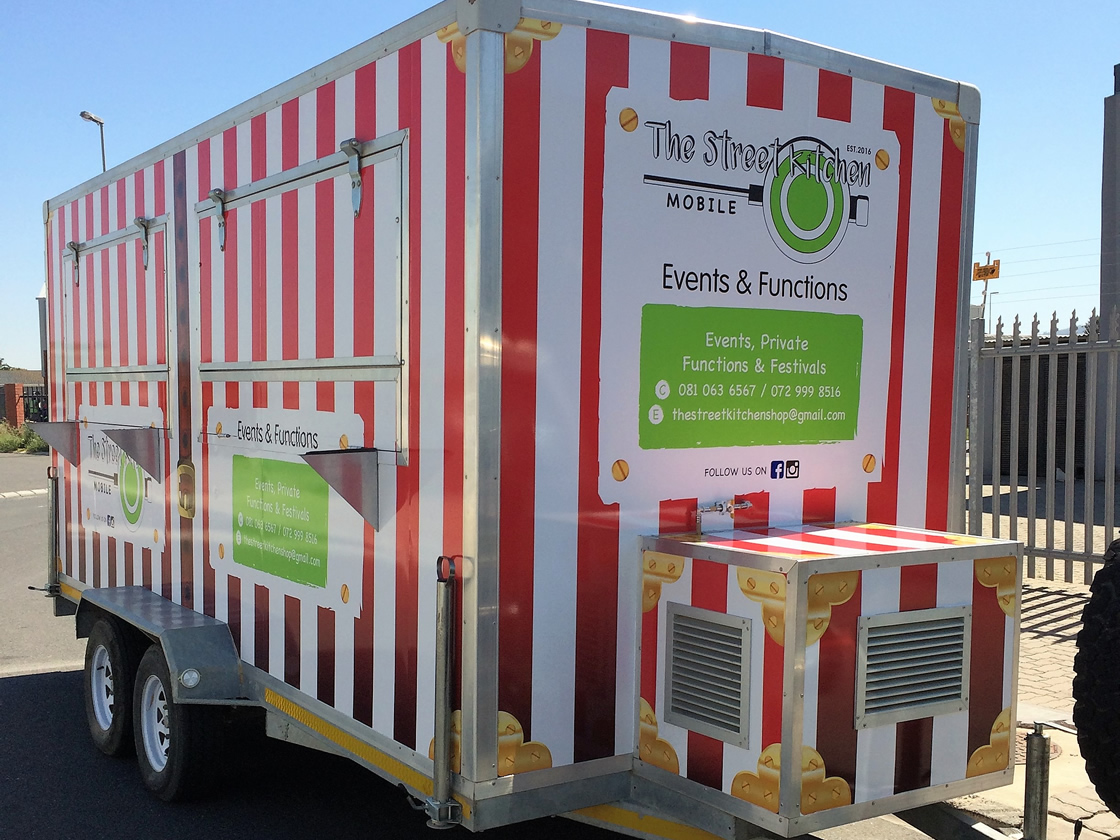This is an example of the trailer and vehicle wrapping, done by Vye Graphics, for The Street Kitchen.